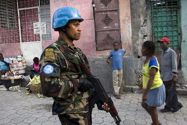 A Sri Lankan peacekeeper from United Nations Stabilization Mission in Haiti (MINUSTAH) patrols the slum of Martissant in the southern hills of Haiti capital Port-au-Prince, where violence is rampant and security measures have been increased since a prison break of about 4,000 convicts.