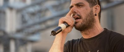 In this photo dated June 21, 2011, rapper Pavlos Fyssas performs on stage. Fyssas, a hip-hop singer with the stage name Killah P and described as an anti-fascist activist, died early Wednesday Sept 18 from two stab wounds to the chest after leaving a cafe in the western area of Keratsini. Police arrested a suspect at the scene, who they say admitted to the killing and identified himself as a member of Golden Dawn. (AP Photo/John D. Carnessiotis)