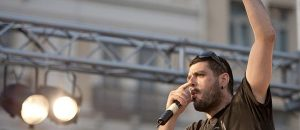 In this photo dated June 21, 2011, Greek rapper Pavlos Fyssas performs on stage. Fyssas, a hip-hop singer with the stage name Killah P and described as an anti-fascist activist, died early Wednesday Sept 18 from two stab wounds to the chest after leaving a cafe in the western area of Keratsini, Greece. Police arrested a suspect at the scene, who they say admitted to the killing and identified himself as a member of Golden Dawn. (AP Photo/John D. Carnessiotis)